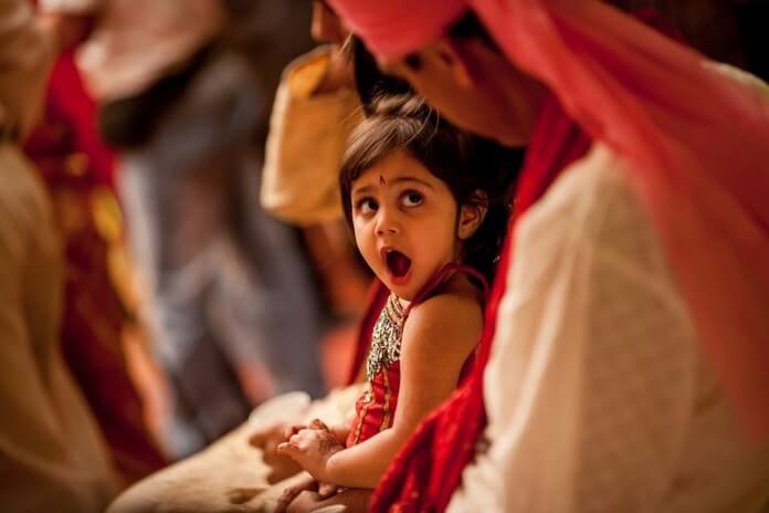 While Taking Your Baby in Indian Wedding