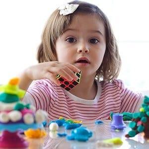 child solve a puzzle